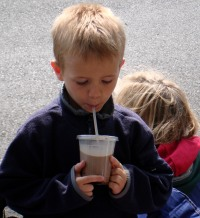 Perfect scale: One chocolate milkshake and one happy little kid.
